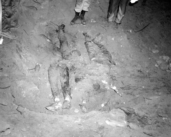 The bodies of James Chaney, Andrew Goodman, and Michael Schwerner..as they were found 44 days after the murder