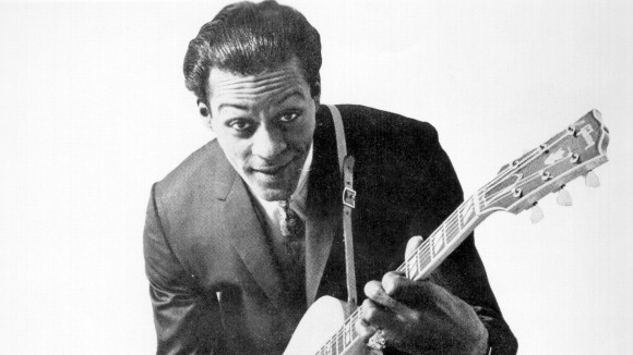 Chuck Berry in 1958, posing with his Gibson hollow-body electricÂ